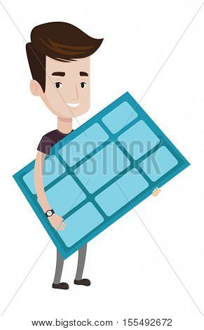 Young happy man holding solar panel in hands. Man with solar panel in hands. Caucasian worker of solar power plant. Green energy concept. Vector flat design illustration isolated on white background.