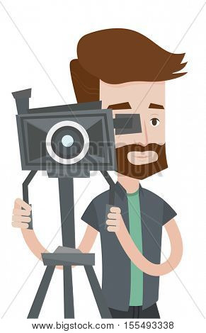 Hipster cameraman looking through movie camera on a tripod. Cameraman with professional video camera. Young cameraman taking a video. Vector flat design illustration isolated on white background.