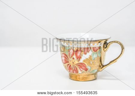 isolated tea cup of colorful porcelain on table