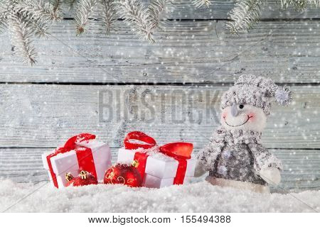 Handmade snowman and christmas decoration on wooden background. Copyspace for text