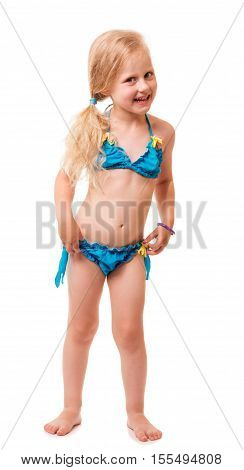 A smiling little blond girl in a swimsuit isolated on white background.