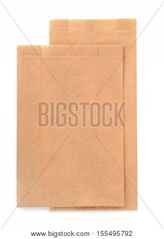 Folded brown kraft paper bags isolated on white