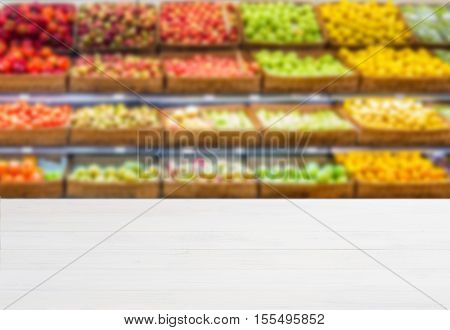 Wooden Empty Table In Front Of Blurred Supermarket Vegetables Shelf