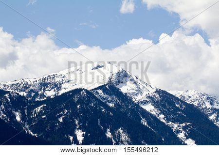 A stunning view of a mountain with snow at Lake Wenatchee, Washington, US