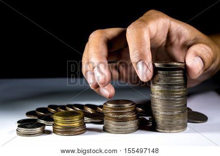 Pile Of Coins And Hand Holding Coins.