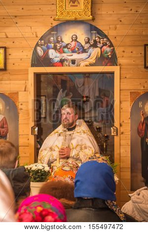 The Priest At The Altar In The Temple. Dobrush, Belarus