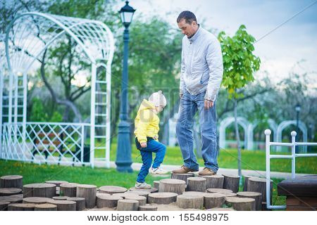 Dad and his daughter are playing in the beautiful spring park