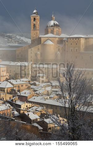 The cathedral of Urbino during winter snowfall