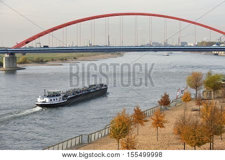 DUISBURG GERMANY - November 04: Barge on the river Rhine on November 04 2016 in Duisburg Germany. Duisburg is the largest river port in Europe (Duisport)