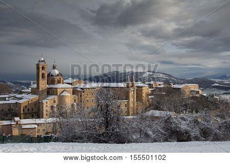 Historic city of Urbino with winter snow