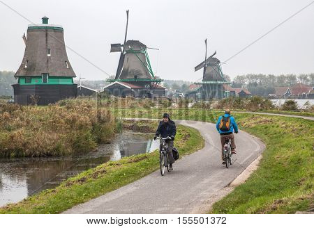 AMSTERDAM, NETHERLANDS-OCTOBER 24, 2016: Unique old, authentic, real working windmills in the suburbs of Amsterdam, the Netherlands.