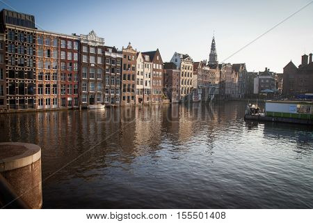 "AMSTERDAM, NETHERLANDS - OCTOBER 24, 2016: Beautiful views of the streets, ancient buildings, people, embankments of Amsterdam - also call ""Venice in the North"". Netherland"