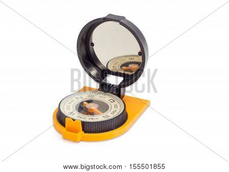 Dry magnetic tourist compass with mirror of sighting mechanisms on a light background