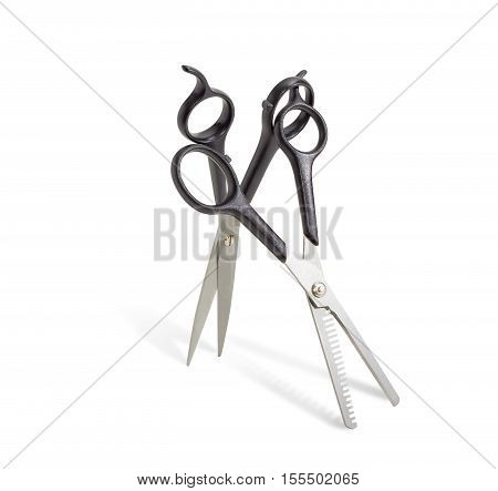 Normal hairdressers scissors and texturizing shears on a light background