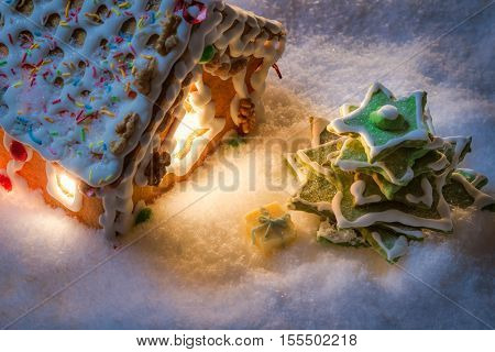 Closeup Of Gingerbread Cottage With A Gift