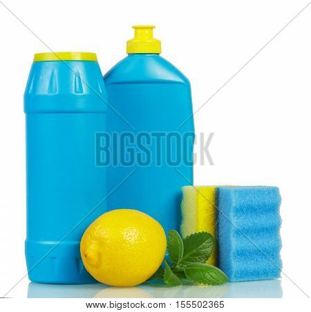 Household chemicals in plastic bottles with the scent of lemon, mint and sponges isolated on white background.