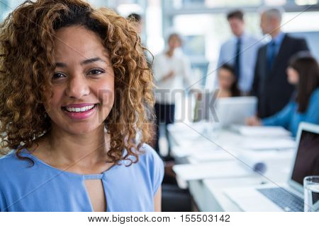 Portrait of beautiful businesswoman smiling in office