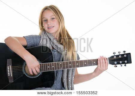 Pretty Ten Year Old With Acoustic Guitar Over White