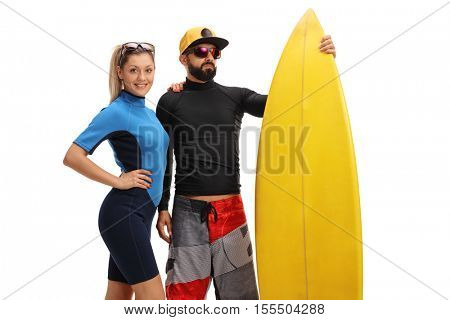Surfers posing with a surfboard isolated on white background
