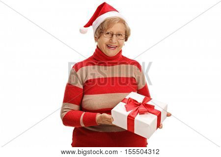 Cheerful elderly woman holding a christmas present isolated on white background