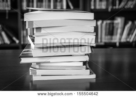 Pile Of Books In A Library And Bookshelf
