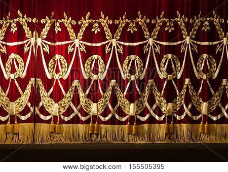 Open red curtains with glitter opera or theater background.