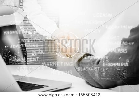 Double exposure of Businessman and businesswoman handshake after successful on target at meeting room business content business backgroundbusiness success.