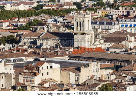 Notre-Dame-et-Saint-Castor Cathedral in Nimes - aerial photo. Nimes Occitanie France.