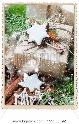 Decoration of Christmas Gift with Cinnamon Cookies Branch Coniferous and Almond Vintage Style Drawn Snowfall Vintage Retro Photo Frame Isolated on White