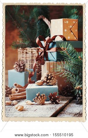 Festive Gifts Boxes Coniferous Basket Cinnamon Pine Cones Walnuts on Wooden Background Vintage Style Drawn Snowfall Retro Photo Frame Isolated on White