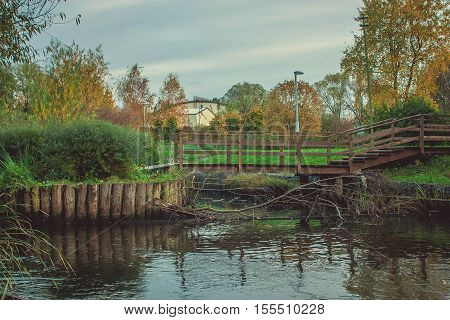 Bridge over the river in the autumn park