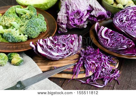 Many kinds of cabbage - red broccoli Brussels sprouts white napa cabbage. Ingredients for the preparation of vegetable dishes.