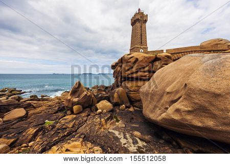 Ploumanach Lighthouse on the shore. Perros-Guirec Brittany France