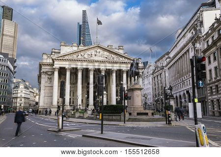 London England - The Royal Echnage building with walking business man