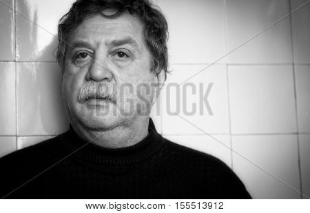 Black and white photography. Portrait of a sad elderly man.