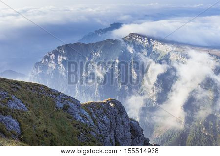 Picturesque View Of A Layer Of White Clouds Below The Mountain Peaks In The Bucegi Mountains From Th