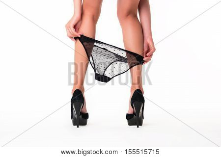 Panties and legs with heels. Black lace underwear. Sensuality and temptation. How to wake the passion.