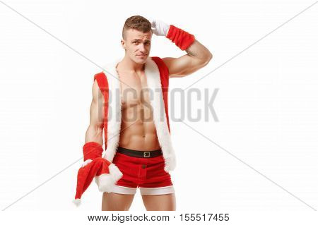 Confused fitness santa isolated on white background. Embarrassed fitness santa. Sexy Santa Claus. Bodybuilder Santa with red box on a white background. Santa Claus isolated