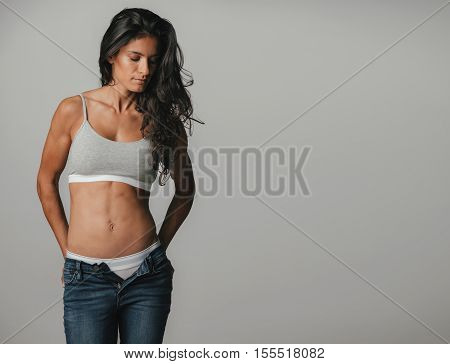 Beautiful Woman With Unzipped Pants Looking Over