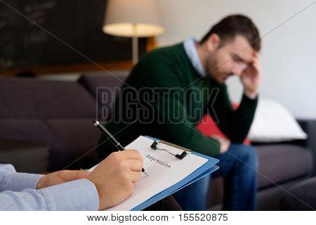Man With Mental Health Problem In The Psychiatrist Studio