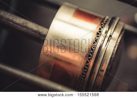 Color close up shot of a motorcycle piston.