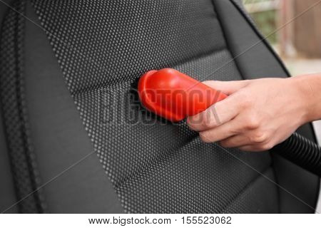 Male hand cleaning car with brush inside