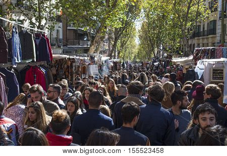 Madrid Spain - November 6 2016: Unidentified persons visiting Rastro street market. Popular open air flea market