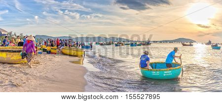 Phan Thiet, Vietnam - July 26th, 2016: Fisherman out to sea by baskets boats bring trade in the fishing village on a sunny morning
