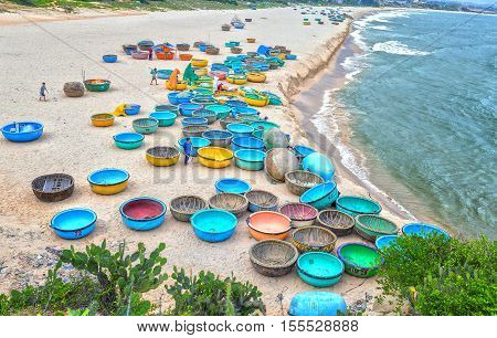 Binh Thuan, Vietnam - July 26th, 2016: Ganh Son Beach on  sunny afternoon with many basket boats lined beach, this is beautiful coastline attract tourists to visit in Binh Thuan, Vietnam