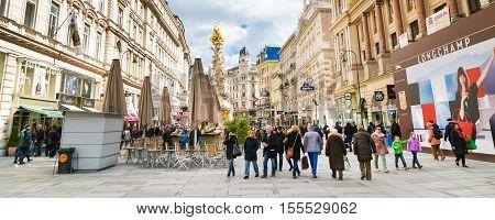 Vienna, Austria - April 3, 2015: Plague column and Graben Street view with people walking in Vienna, Austria