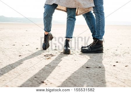 Cropped image of a casual couple standing together at the seashore