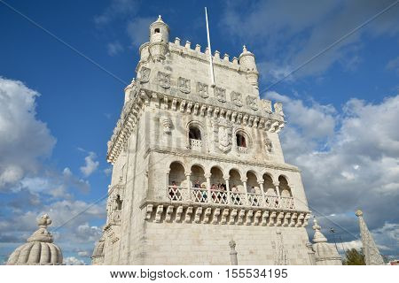LISBON, PORTUGAL - OCTOBER 20: Tourists visit the famous Belem Tower, a prominent example of 16th century Manueline style in Portugal OCTOBER 20, 2015 in Lisbon, Portugal