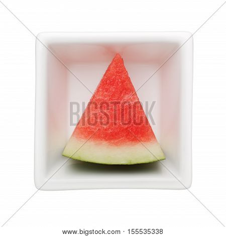 Slice of watermelon in a square bowl isolated on white background