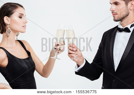 Serious business people with champagne. white background. eyes to eyes